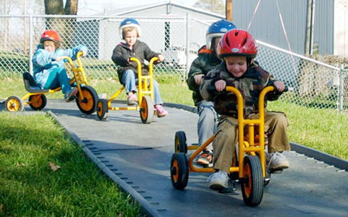 HELP students on tricycles