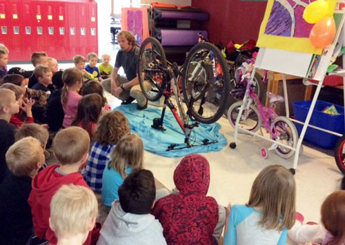 WUPHD Health Educator Arnie Kinnunen talks to students at Calumet Elementary School about bike safety.