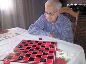 Rex McMahill Plays Checkers