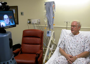 Remote physician talks with a patient via medical robot