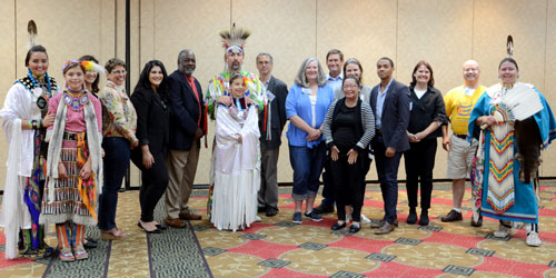 The Williams family (in Native dress) performed dances for the NACRHHS committee members and staff.