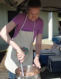 Dr. Alice Ammerman preparing food