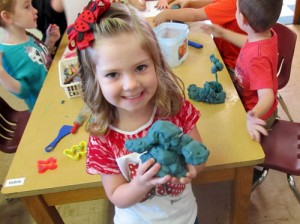 """Brianna Hale holds her clay model of """"Jumping Jackie,"""" one of CATCH's characters that helps students learn about health and nutrition."""
