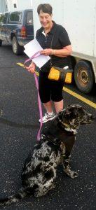 Allegan Farmers Market customer and dog