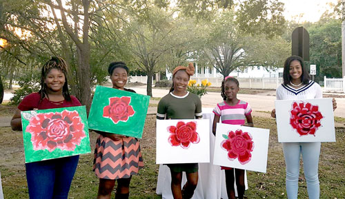 Tea Time with Teens participants with paintings from mother-daughter event