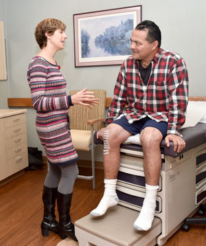 Care coordinator Shannon Nelson visits with patient Dan Vargas