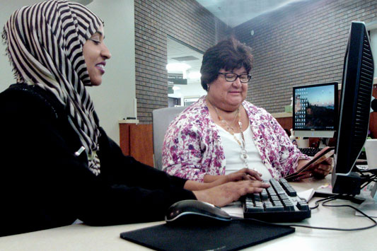 Community Health Worker Maria Reyes and Interpreter Sahra Ali