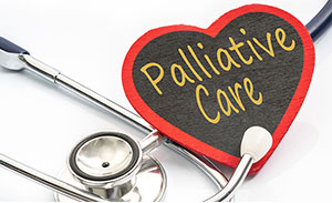 palliative care text written on a heart, with stethoscope