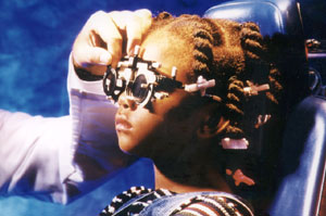 child getting eye exam, image source: National Eye Institute