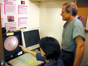 Dr. Mark Horton reviewing a retinal image.