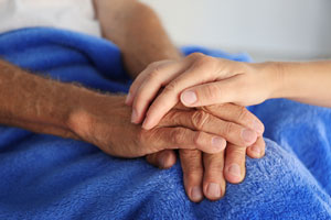 a patient's hands being held