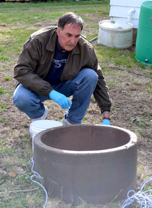 Bryan Swistock collects water quality samples