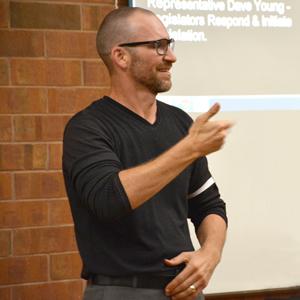 RID-certified ASL interpreter Kirk Neuroth interprets