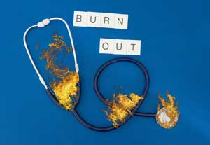 Burnout graphic featuring a stethoscope on fire