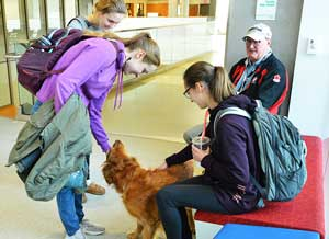 Therapy dog with University of North Dakota School of Medicine and Health Sciences students.