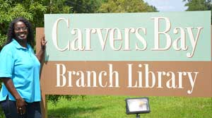 Marilynn Lance-Robb by Carvers Bay Branch Library sign