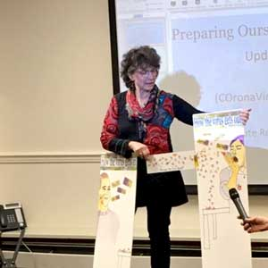 Public health expert presenting at library