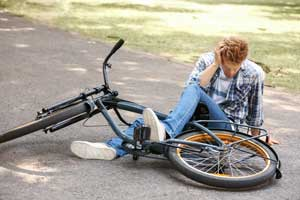 boy who has fallen off a bicycle