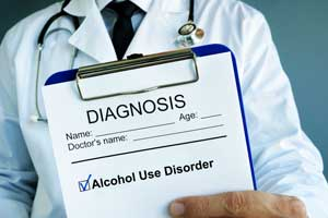 clipboard showing a diagnosis of alcohol use disorder