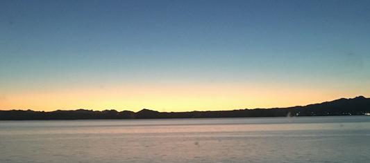 An Arizona sunset from the lakeshore of an Arizona lake.